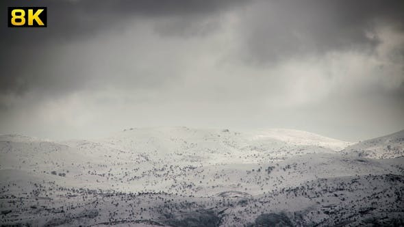 Thumbnail for Snowy Hills With Sparse Trees in Winter