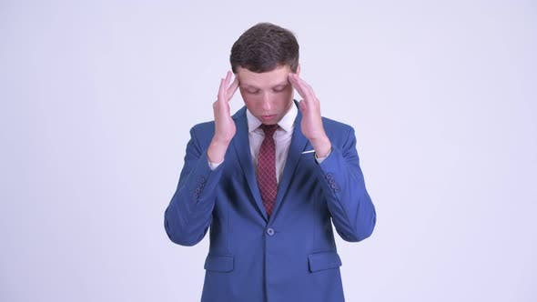 Thumbnail for Stressed Young Businessman Having Headache