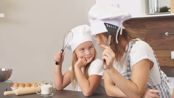 Thumbnail for Cheerful Woman and Child Ponder on the Recipe of the Cupcake, Concept of Family