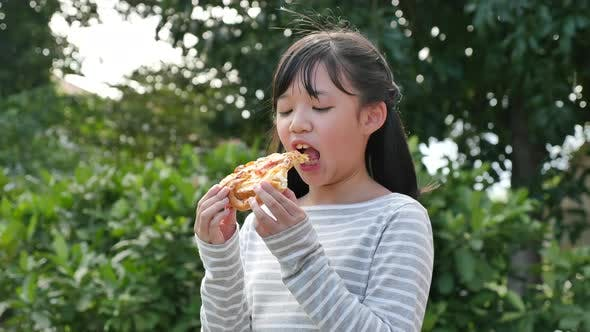 Beautiful Asian Girl Eating Eating Pizza Outdoor