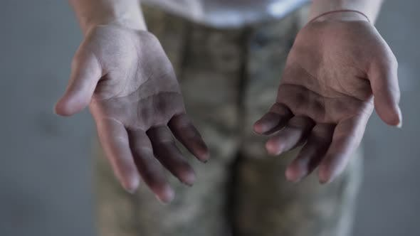 Thumbnail for Dirty Hands of Young Woman in Military Uniform After Training