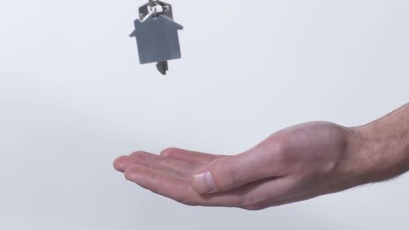 Thumbnail for Broker Putting Key from New House in Buyer's Hand, Purchase of Real Estate