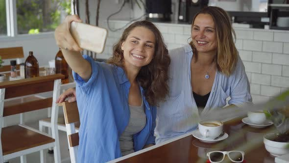 Thumbnail for Lesbian Couple Dating in Cafe. Two Beautiful Women Taking Selfie Photo