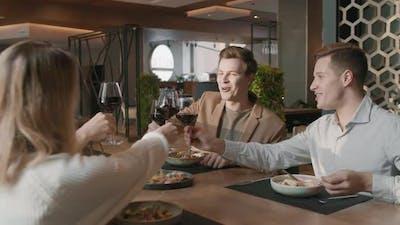 Friends Celebrating In Restaurant