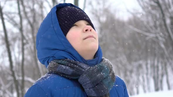 Thumbnail for Portrait Young Teenage Boy Enjoying Snow in the Winter Forest