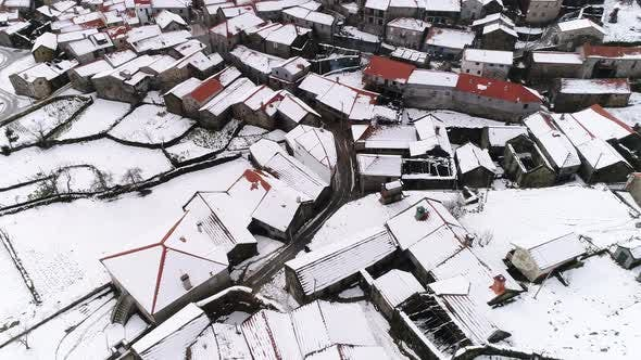 Thumbnail for Flying over Village Covered by Snow at Winter Time