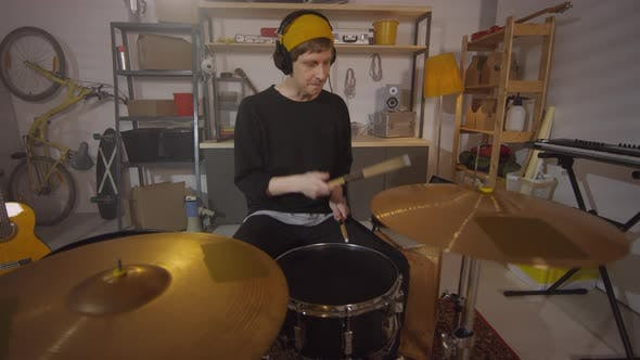 Thumbnail for Drummer Practicing In Garage