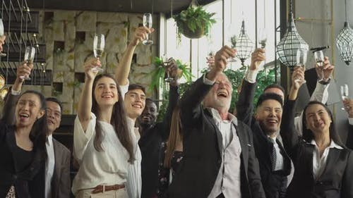 Group of business people toasting champagne to celebrate on New Year