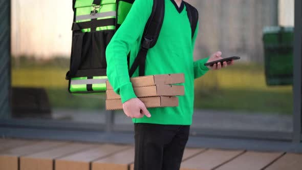 Thumbnail for Young Pizza Courier Is Delivering an Order.