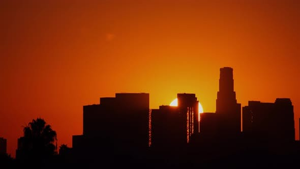 Thumbnail for Time Lapse of the sun rising from behind downtown Los Angeles