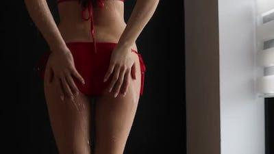 Crop Seductive Woman in Bikini Taking Shower