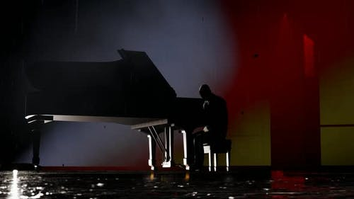 Man Playing Piano While Rain