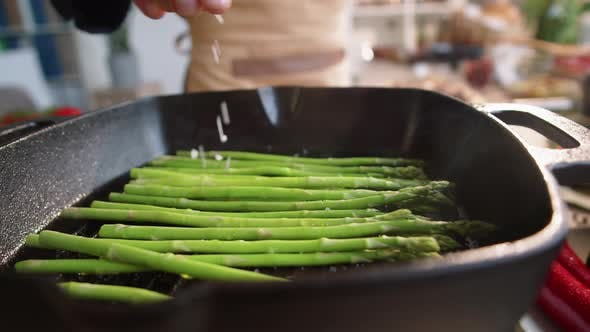 Thumbnail for Chef Salting Asparagus on Grill Pan