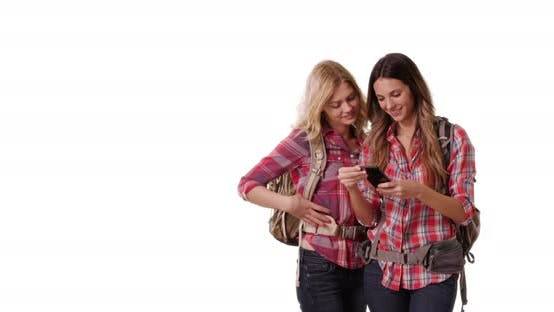 Thumbnail for Portrait of two pretty backpacking females taking selfie on white copy space