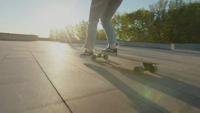 Female Skateboarder Skateboarding in City at Sunrise