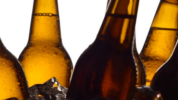 Thumbnail for Bottles with Beer, They Spin in the Ice. White Background