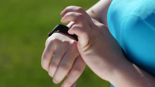 Thumbnail for Slimming Woman Jogger Using Fitness Bracelet
