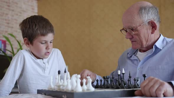 Development of Logical Thinking, Cheerful Grandfather with Glasses for Vision Plays Board Games with