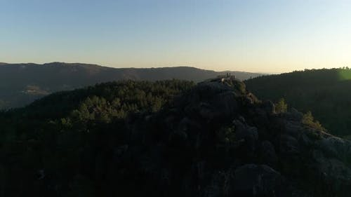 Couple on the Top of Mountain at Sunset