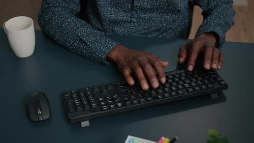 Black African American Person Typing on PC Keyboard