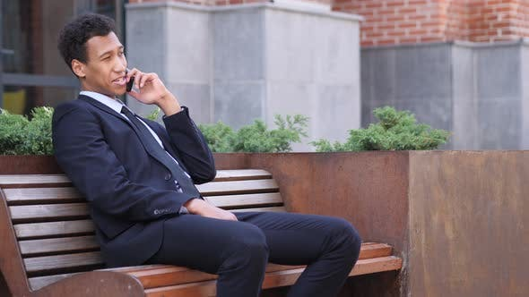 Thumbnail for African Businessman Talking on Phone