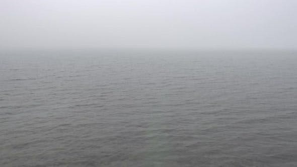 Morning Calm Water Surface with Fog, Looped Video.