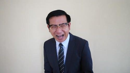 Happy Businessman laughing look at camera