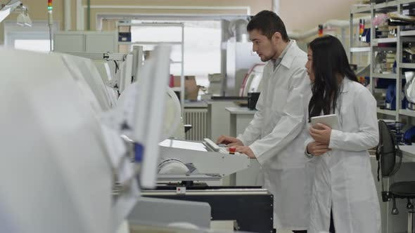 Cover Image for Electronic Technicians Working Together