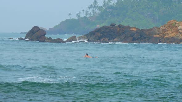 Thumbnail for Woman Catches Wave Standing on Surfboard Against Landscape