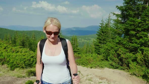 Thumbnail for Caucasian Middle-aged Woman Climbs a Mountain. Active and Healthy Lifestyle