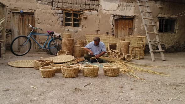Thumbnail for Old Man Making A Bamboo Basket