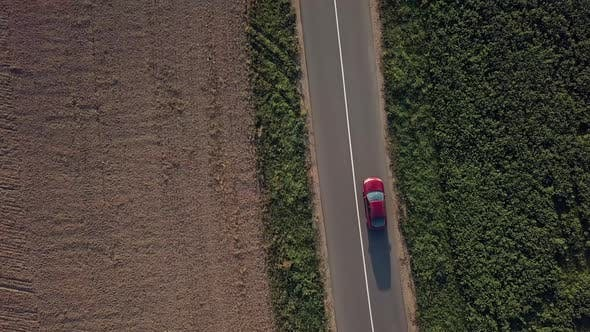 Thumbnail for Moving Car, aerial. Aerial shot of a moving car on the countryside highway.