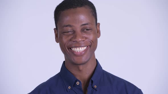 Face of Young Happy African Businessman Smiling