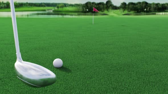 a Golf Ball Rolls Across the Course Into a Hole After Being Hit By a Golf Club