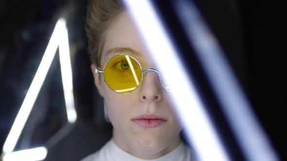 Thumbnail for Portrait of Teenage Girl Wearing Futuristic Sunglasses