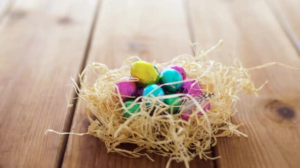 Thumbnail for Chocolate Easter Eggs in Straw Nest on Table