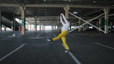 Contemporary Street Dancer Man Funky Urban is Dancing Freestyle in the City