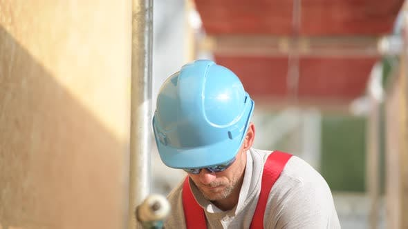 Construction Worker in Blue Hard Hat