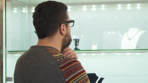 Thumbnail for Bearded Mature Man Choosing Jewelry Present at the Shopping Mall