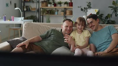 Couple With Child Watching TV
