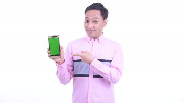 Thumbnail for Happy Japanese Businessman Showing Phone and Giving Thumbs Up