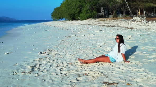 Thumbnail for Pretty fun women on holiday in the sun on beach on sunny blue and white sand 4K background