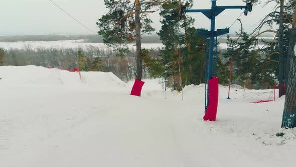 Thumbnail for Surface Lift at Ski Resort on Hill with Pines at Snowfall