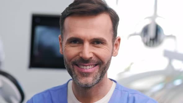Portrait of smiling male stomatologist at work