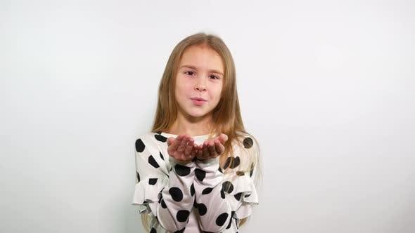Thumbnail for Sweet blonde young girl sending air kiss.