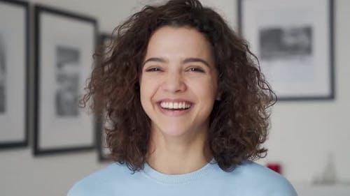 Happy Cheerful Young Pretty Hispanic Woman Laughing Looking at Camera