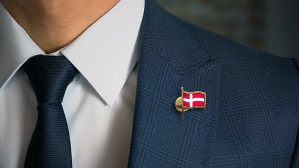 Businessman Walking Towards Camera With Country Flag Pin Denmark