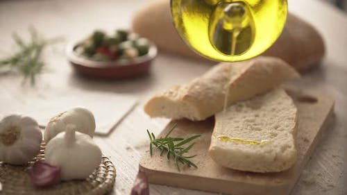 Rustic bread and olive oil ready to make toasts