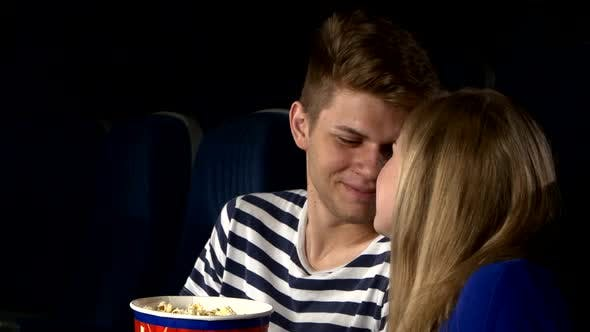 Thumbnail for Couple Feeding Each Other at the Cinema. Close Up