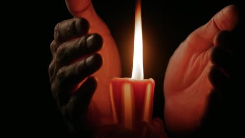 Palm Hands Warming From Burning Candle